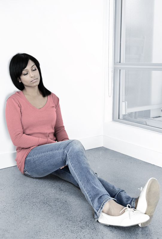Tired woman sitting on the floor