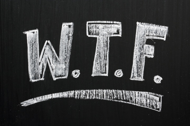 The phrase WTF written on a blackboard in white chalk letters